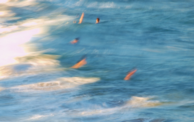 Blurred swimmers in action