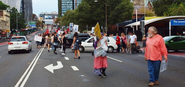 Walking in unison only to be broken by traffic #marchinmarch