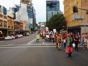 Protesters walking in unison on the Sydney city streets #marchinmarch