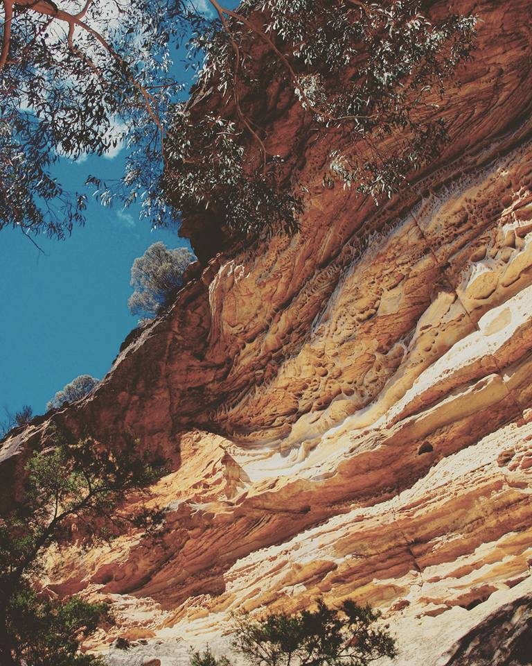 wind eroded cave blue mountains